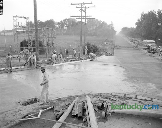 Workmen pictured as they finished first half of new concrete on Nicholasville road at its junction with Rose and Limestone streets.  Nov. 14, 1946