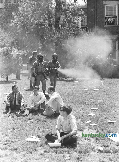 University of Kentucky students meeting with their class outside on campus are caught up in the spraying of tear gas by National  Guardsmen. The Guard was ordered to help break up student demonstration on  campus May 7, 1970. Photo by Paul Lambert, Herald-Leader staff