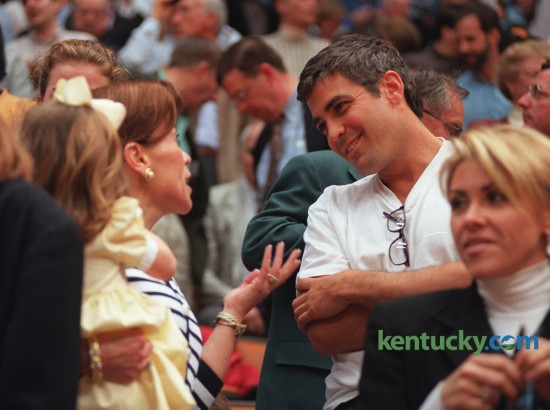 Kentucky native and actor George Clooney with Joanne Pitino, wife of UK coach Rick Pitino, before the 1996 NCAA Basketball tournament championship game between the Wildcats and Syracuse on April 1,1996 in the Meadowlands in Newark, NJ. Photo by Charles Bertram