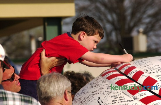 Five-year-old Blake Barhorst from Morehead is held by his dad Tod as he signs the giant baseball at the Lexington Legends home opener at Applebee's Park April 9, 2001. The Legends are a single-A minor league baseball team that started as an affiliate of the Houston Astros, but are now part of the Kansas City Royals farm system. In their inaugural season, the Legends made it to the South Atlantic League Championship Series, however the series was canceled after two games because of the Sept. 11 terrorists attacks. The Legends were named co-league champions with the Asheville Tourists.