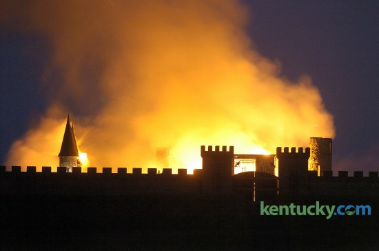 "The landmark castle on Versailles Rd. in Woodford County on fire May 10, 2004. Deceased Lexington contractor Rex Martin Sr. started building the castle in 1969. But it was never finished and sat empty for more than 30 years. Tom Post spent millions of dollars and several years rebuilding the landmark into a luxury inn. Improvements started by Post were nearly complete when the fire destroyed the building. The state fire marshal's office concluded there was ""a high probability"" that an arsonist set the fire, but nobody was ever charged. Now the castle is called CastlePost and features 10 luxury rooms and suites and is a popular for wedding receptions and charitable events. Photo by David Perry, Herald-Leader staff"