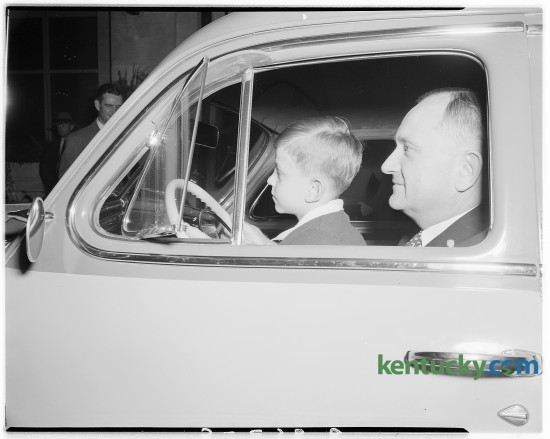 Adolph Rupp, University of Kentucky basketball coach and Herky, his son. Rupp was presented with a new car by members of Junior Chamber of Commerce at a dinner in his honor Sept. 23, 1946 at the Lafayette Hotel.