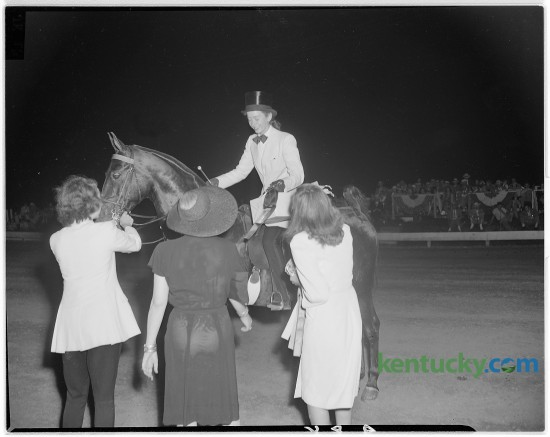 """Five Minutes to Midnight, owned and ridden by Miss Jean McLean of Portsmouth, Virginia, captured the Three-Gaited Amateur Stake at the Lexington Junior League Horse Show, July 1946. The horse show started in 1937, to help fund the Junior League's community works project. It has grown to be the world's largest outdoor American Saddlebred show and the first leg of the Saddlebred """"Triple Crown"""". This years horse show begins Monday, July 7 and concludes Saturday."""