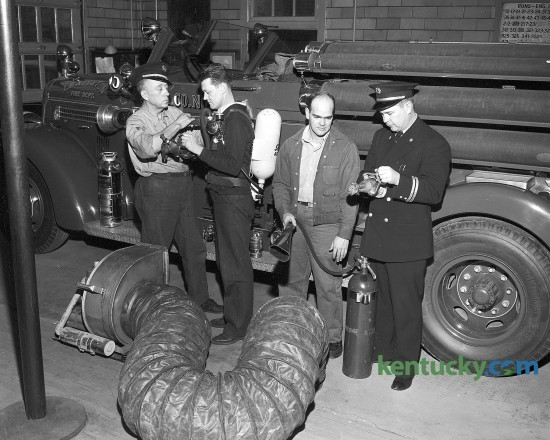 Lexington Fire Department personnel inspecting new equipment Dec. 12, 1950.  From left, W. T. Kerns, E. F. Petit, Jimmy Smith and Fire Chief Earl McDaniel.