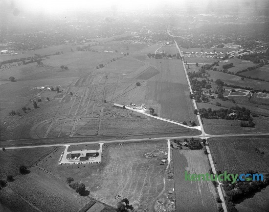 Grading had begun in August of 1956 for International Business Machine Corporation's new factory at the intersection of New Circle Rd. (running from left to right across the picture) and Newtown Pike. The 386,000-square foot typewriter plant employed 1,800 people when it opened. By 1985 IBM had 6,000 workers, second only to the University of Kentucky's 7,500.