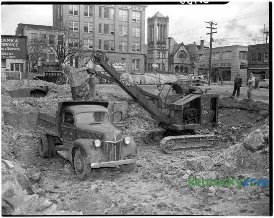 Excavation of the west portion of the old post-office lot begun at Main and Walnut streets in March of 1946, for the construction of new Martin's Blue Grass Fashions store.  Walnut St. is now called Martin Luther King Blvd. In the background is a Sears-Roebuck store and Central Christian Church.