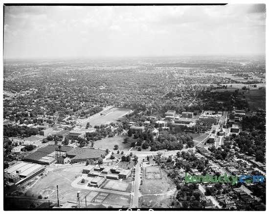 Aerial shot of University of Kentucky campus, 1945. Running from left to right across the picture is South Limestone St. Memorial Hall is on the left side, about halfway up, and Stoll Field is just to the left of center.