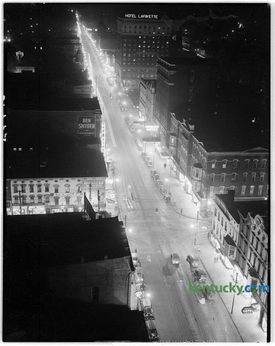 View of Main St. downtown Lexington at night time, 1944. Picture taken looking towards the east. At top is the Lafayette Hotel, which is now the offices of the Fayette Urban Lafayette Hotel Government.