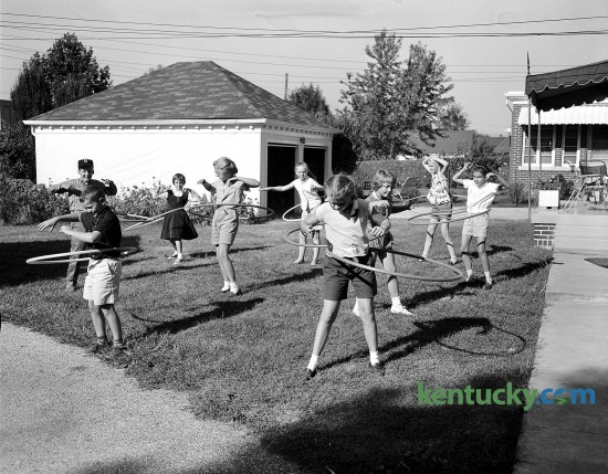 A group of youngsters with hula hoops, Sept. 1958. According to hulahooping.com, the craze lasted from January to October 1958, then died out suddenly. It is estimated that over 100 million hoops were sold in its first year. The original price per hoop was $1.98.
