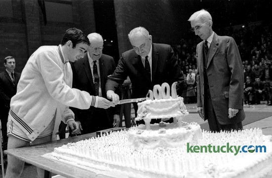 From left, UK basketball team captain Phil Argento, 1905-07 team member Thomson Bryant, UK coach Adolph Rupp, and Wylie Wendt, manager of the 1906 team, cut a large cake Jan. 13, 1969 as the Wildcats officially celebrated 1,000 basketball wins dating back to Feb. 18, 1903.