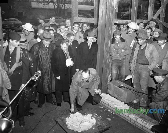 University of Kentucky basketball coach Adolph Rupp mixes mortar during a cornerstone-laying ceremony Feb 21, 1949 at the construction site of Memorial Coliseum. Completed in 1950, Memorial Coliseum not only served as home-court for the Wildcats, it's also a memorial to the more than 10,000 Kentuckians killed in World War I and the Korean Conflict. The UK men's basketball team played in Memorial from 1950 to 1976, compiling a record of 306-38 (.890).