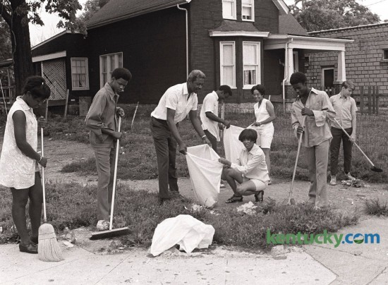 City Commissioner Harry Sykes, center, joined  officials of Micro-City Government in a neighborhood cleanup on  East Third Street on July 14 1971. Others in photo are from left  Sandra Young, Vincent Caise, Sykes, Pat Tribble and James  Clayborne. At rear from left are James Johnson and Linda Parr.