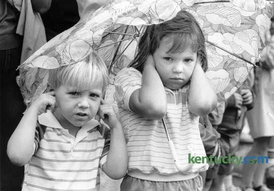 Richard Mattmiller, 4 and sister Karol Mattmiller, 5, held their ears as semi-trucks blowing their horns passed them during the downtown parade on July 4, 1984. Photo by Gary Landers Herald-Leader staff