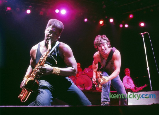 Bruce Springsteen watched Clarence Clemons play the saxophone during a December 11, 1984 concert before 23,000 fans in Rupp Arena in Lexington. Clemons, a prominent member of the E Street Band, died in 2011 of a stroke. Photo by Charles Bertram | Staff