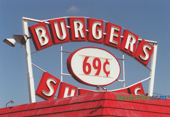 Sign for the Burger Shakes restaurant on New Circle Road, March 25, 1999. In 1957, Burger Shakes opened on the Northern Beltline, now known as New Circle Road. back then burgers and shakes were 19 cents, fries cost 14 cents, and Cokes were a dime. Today the sign says 99 cents.