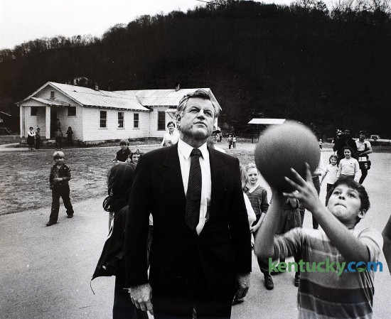 U.S. Senator Edward Ted Kennedy watched school children shoot basketball at the Spruce Pine Elementary School in Honaker, Ky., as part of his nationwide survey of hunger in America tour, on Nov. 23, 1983. Kennedy, who was a seven-term Democratic senator form Massachusetts, visited Floyd and Letcher counties. Kennedy was the fourth-longest-serving senator in U.S. history when he died in 2009. Photo by Charles Bertram, Herald-Leader staff