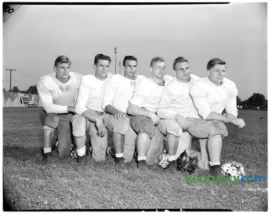 "Newcomers on the University of Kentucky football team in Sept. 1946 included future UK coach  Jerry Claiborne, second from right. Claiborne played three years as halfback under Paul ""Bear"" Bryant. He went on to become the head coach at Virginia Tech (1961–1970) and  Maryland (1972–1981) before returning to UK in 1982. In his eight seasons as head coach, he led the Wildcats to two bowl games and a record of 41-46-3. He was inducted into the College Football Hall of Fame in 2000.  In the photo from left to right is Harry Ulinski, Nick Odlivak, John Ciepalich, J. C. Williams, Claiborne and Dick Holway. Published in the Lexington Leader September 17, 1946."