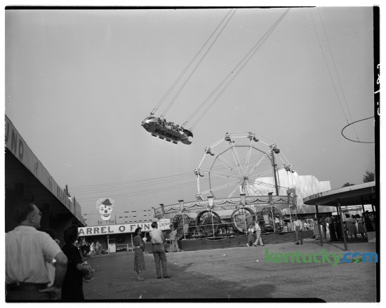 """Lexington's Joyland Amusement Park was located in north east Fayette County off of North Broadway. This photo was taken in August of 1948 during the Kentucky Press Association sponsored picnic and square dance contest.  It was considered the """"Best known park in the Bluegrass"""" with two roller coasters, the Wildcat, and the Kiddie Coaster.The park closed in August 1964 and was torn down in 1965 replaced by the Joyland neighborhood."""
