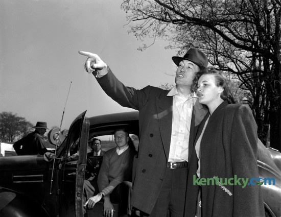 """Movie director John Huston talked to actress Jean Hagen during the filming of the final scene of """"The Asphalt Jungle"""" in 1949. The film also starred Sterling Hayden and parts of it were filmed in Lexington on the Ben Eubank farm on Briar Hill Road. Published in the Lexington Leader October 14, 1949. """"The Asphalt Jungle"""" is a 1950 film noir  based on the 1949 novel of the same name by W. R. Burnett."""