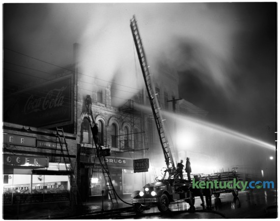 A fire damaged the Eagles Club at 139 North Broadway in March of 1950. Lexington fire fighters fought to extinguish the flames. The building was saved and is currently the law offices of Garmer & Prather, PLLC. To the right is the Lexington Opera House. Published in the Lexington Herald March 30, 1950.