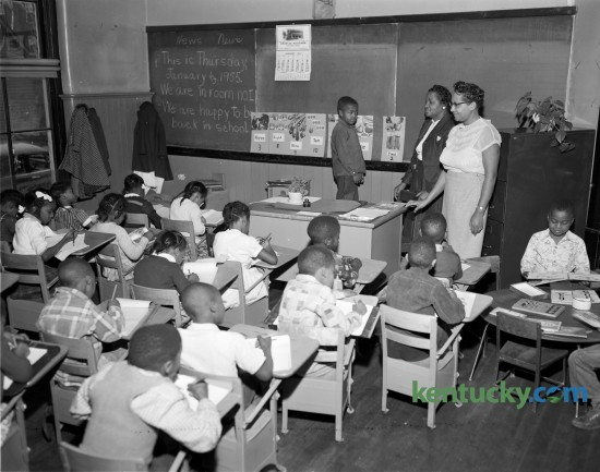 Mrs. R. A. Buford's second grade class  from Douglass Elementary School, began classes in January 1955 in the old Russell School building because their school was destroyed by fire on January 1. Published in the Lexington Leader January 6, 1955.