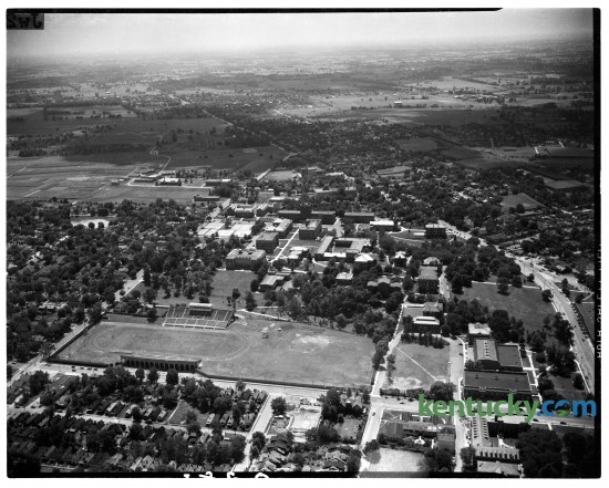 Aerial view of the University of Kentucky campus, 1945-1946. Avenue of Champions runs left to right near the bottom of the photograph with Stoll Field and McLean Stadium, center, lower left. It was the home of the University of Kentucky Wildcats football team. The field hasd been in use since 1880, but the concrete stands were opened in October 1916, and closed following the 1972 season, and was replaced by Commonwealth Stadium.  This was taken prior to Memorial Coliseum which was built in 1950.