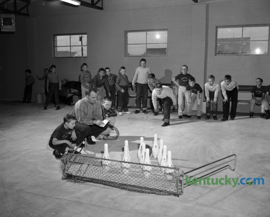 Youngsters shown with bowling set at the new Meadowthorpe Recreation Center, sponsored by the County Playground and Recreation Board. Published in the Lexington Leader January 21, 1958.