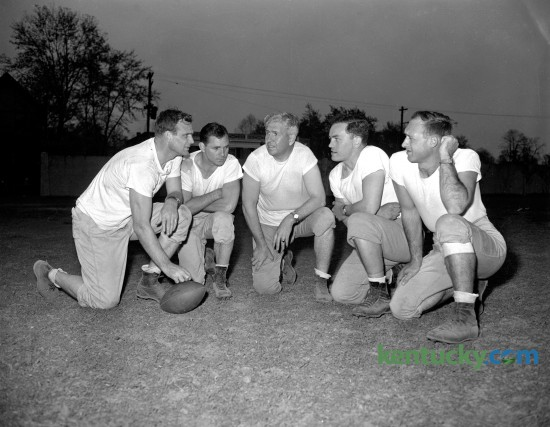 "University of Kentucky football coaching staff in the spring of 1946, ""Bear"" Bryant's first season at UK. Pictured from left  are head coach Paul ""Bear""  Bryant, Frank Moseley and Carney Laslie, all products of Alabama football, Mike Balitsaris, former Tennessee end, and Joe Atkinson, former captain and guard at Vanderbilt. The caption published in the Leader on April 16, 1946 said  ""this is the first photograph of the complete lineup of the Wildcat's new pigskin professors."""