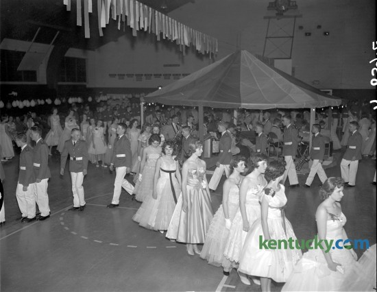 Millersburg Military Institute Cadets entertained with their Annual Ball on April 9, 1960. The Grand March brought all cadets and their dates to the dance floor. The Military Ball was held annually by MMI Junior School and music was furnished by the school orchestra.