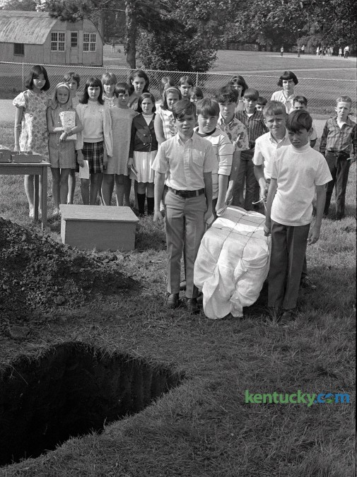 Dorothy Hellard's sixth grade class at Picadome Elementary  School prepared to bury a time capsule containing about 200 items on Friday  May 31, 1968. The container was buried in a concrete vault  and among the items it contained were bubble gum, a calendar, tape recording of students  voices, a city map signed by Mayor Fred Fugazzi, a card from the  White House signed by President Lyndon Johnson and a Kentucky flag signed by  Governor Louie Nunn. The time capsule was unearthed in 2004 when a backhoe was working near the school. Students contributed additional items from 2004 and the capsule was reburied.  Photo by Frank Anderson | Staff