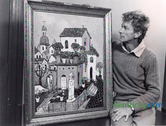 Eccentric Lexington artist and poet Henry Faulkner with one of his paintings, March 30, 1977. Faulkner, a close friend of Tennesee Williams was born in eastern Kentucky in 1924.  He moved to Lexington in 1956 and became well know for both his critically acclaimed paintings and his flamboyant lifestyle. Faulkner died in 1981. Photo by John C. Wyatt | Staff