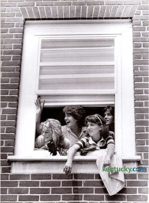 Four incoming University of Kentucky freshmen waved at friends from a third floor window of Jewell Hall in August of 1980. From left are Kim McClaskey, Rochester, NY, Sandy Pulsfort, Ft. Thomas, Ky., Michele Stephens, Verona, Ky., and Missy Embree, Long Island, NY. Photo by Christy Porter | Staff