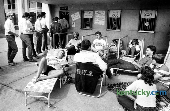 "A group of UK students waited outside the ticket office at Memorial Coliseum on Sept. 4, 1984, for the ""good"" seats to become available for UK football's 1984 season opener at Commonwealth Stadium. The group had been waiting since 8:30 a.m. for the release of tickets at 6 p.m. for sections 208 and 210. The line on the left was for the rest of the seats. Photo by Charles Bertram 