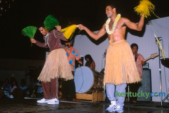 In November of 1985 the University of Kentucky basketball  team traveled to Hawaii to play two games during Thanksgiving week. On November 25, the off day between games  with Chaminade and Hawaii,  freshman Irving Thomas and junior Paul Andrews competed in a hula contest. Andrews was named the winner. Photo by Ron Garrison | Staff