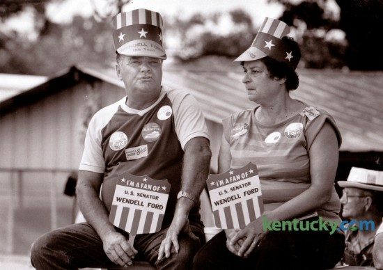 Randle Darnell and Marge Eastin, both of Benton, Ky., showed their support for several candidates as the waited for the speeches to begin at the 106th Fancy Farm Political Picnic at St. Jerome's Church in Fancy Farm, Ky., August 2, 1986. Photo by Charles Bertram | Staff