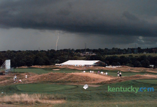 Severe thunderstorms halted play August 8, 1996 at the 78th PGA Championship at Valhalla Golf Club in Louisville. Thunderstorms scattered thousands of fans and interrupted play for almost four hours. But the weather didn't bother Kentucky native Kenny Perry, who took the first-round lead after sinking a 20-foot putt in the fading light as play was ended at about 8:30pm with 60 players still on the course. Photo by Michelle Patterson | Staff