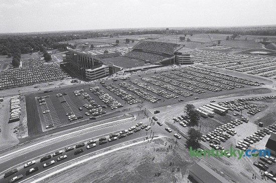 Traffic outside Commonwealth Stadium on Sept. 15, 1973, prior to the first game played at the new home of the Wildcats. After playing 48 years at Stoll Field, the Cats won their first game at Commonwealth, 31-24 over Virginia Tech. The stadium and parking rest on what was once part of the UK Experimental Station Farm Grounds. Commonwealth Stadium had a capacity of 57,800 cost $12 million to build - a tenth of the cost for the current renovation.