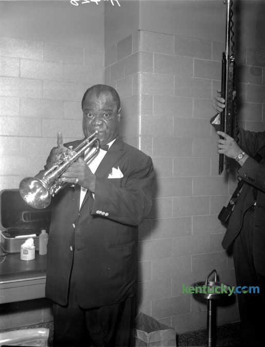 "Trumpeter Louis ""Satchmo"" Armstrong warmed up backstage before an appearance for Greek Week at the University of Kentucky in 1960. Published in the Lexington Herald February 20, 1960."