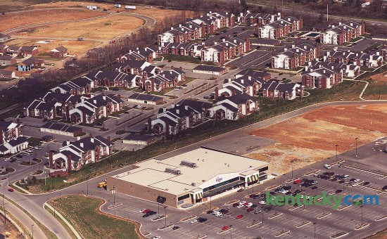 Aerial photo looking at the new Kroger and apartments in the Beaumont Farm development on Harrodsburg Rd. at New Circle Road in Lexington, March 6, 2000. The 63,000-square-foot Kroger anchored the new shopping center, which covered a total of 250,000 square feet on more than 30 acres of land. Neighbors in the Harrods Hill subdivision originally objected to the plan, which had called for an unnamed 123,000-square-foot store next to Kroger. After meeting with neighbors, the size of the store was reduced to 50,000 square feet. Years later the Kroger expanded to what it is now, a 125,000-square-foot MarketPlace store. Photo by Charles Bertram | staff