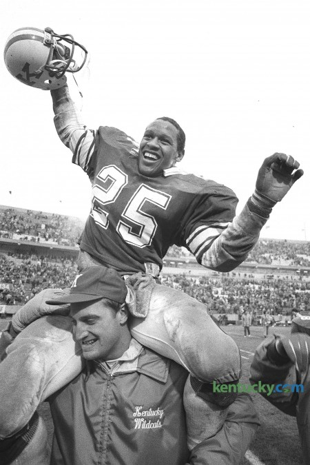The University of Kentucky's Marc Logan got a ride off the field on the shoulders of running backs coach Greg Nord after the Wildcat's 10-3 victory over the University of Florida on Senior Day, November 15, 1986 at Commonwealth Stadium. The win snapped a six-game losing streak against the Gators. Unfortunatily for Kentucky they have not beated Florida since that game 24 years ago. This was Logan's last game at home. He is seventh on UK's career rushing list with 1,769 yards. He went on to play 10 years in the NFL, winning a Super Bowl with San Francisco in 1995. Photo by Charles Bertram | staff