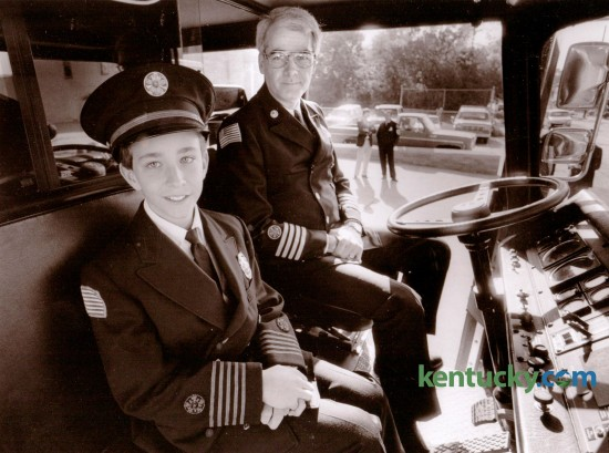 Colby Justice, 11, a sixth grader at Squires Elementary School was named Lexington' s Junior Fire Chief in October of 1988. Justice, son of Richard and Ann Justice, sat in the cab of the snorkel truck at Station One with Lexington Fire Chief Gary McComas on October 7, 1988. Photo by Michael Malone | Staff