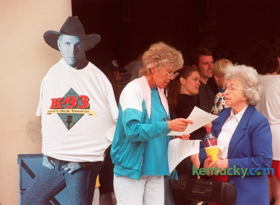 Della Mitchell of Richmond, left, talks with her mother, Helen Rogers of  Lexington, right, about the rules for the wristbands they received in the lottery for Garth Brooks concert tickets at Rupp Arena on Wednesday, April 15, 1998. Brooks first of three Lexington shows was Friday May 15. Photo by Michelle Patterson | Staff