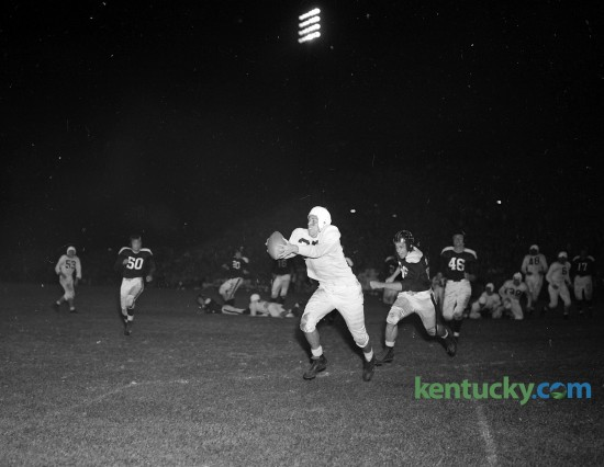 """Wallace """"Wah-Wah"""" Jones caught Bill Boller's 11-yard pass for a touchdown during Kentucky football's 70-0 win over Xavier Oct. 5, 1946 at Stoll Field. Wallace """"Wah Wah"""" Jones, widely considered the greatest all-around athlete in UK history, played both football and basketball for the Cats. As such, he held the distinction of playing for two lionized coaches: Adolph Rupp in basketball and Paul """"Bear"""" Bryant in football. On the gridiron Jones was was an all-Southeastern Conference player and on the hardwood he was a member of the Fabulous Five, the basketball team that in 1948 won the first of UK's eight national championships."""