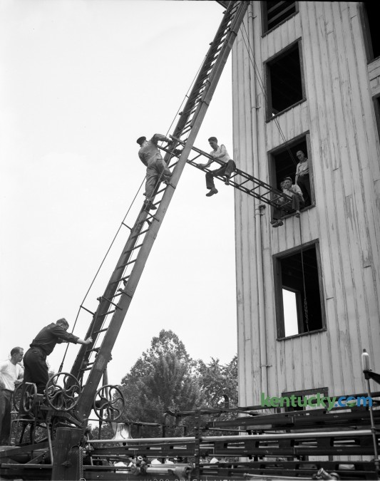 Lexington firemen demonstrated an aerial bridge during training at a fire school in 1948. Published in the Lexington Leader June 10, 1948.