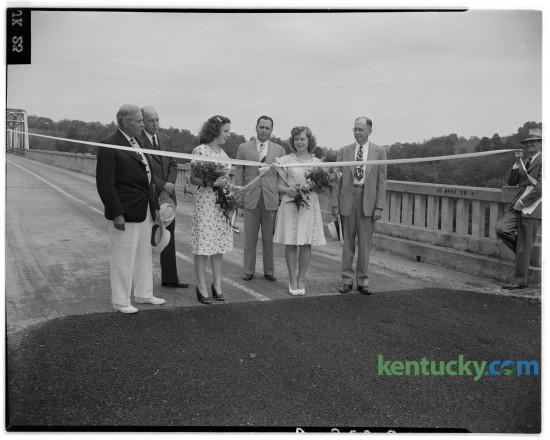 Judge V.W. Bush, of Winchester, William Caywood, Patricia Ann Moore, Lieutenant Governor Kenneth H. Tuggle, Mary Elizabeth Moore and B.E. Willis at the freeing of the Boonesborough bridge over the Kentucky River in August of 1945. Published in the Herald-Leader August 26, 1945.