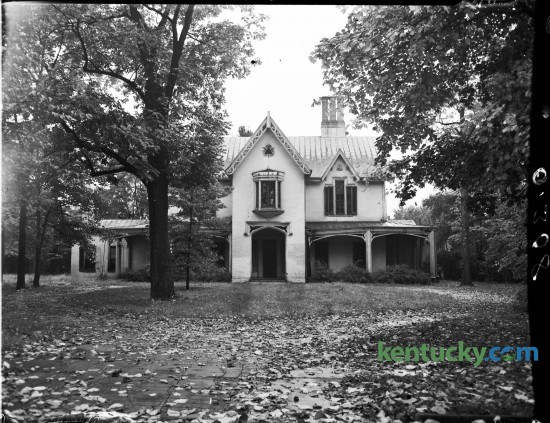Aylesford House, originally known as Elley Villa,  a Greek Revival residence at 320 Linden Walk, photographed in 1944. The house was built in mid-1850s by John McMurtry, noted Lexington architect-builder, for William R. Elley,  a Mississippi cotton planter who's wife Louisa had grown up in the nearby Pope Villa. McMurtry also designed Ingleside and Loudoun, among other houses.  Several outbuildings and a race course once existed behind the villa. The property passed to John L. Barclay and then to Judge William C. Goodloe, who became owner of the house in the 1860's.  In 1875 St. Joseph Hospital was established there and operated until 1878. General W.T. Withers next occupied the house.  Oliver Perry Alford purchased the property in 1885 and named it Aylesford.  It was occupied by the University of Kentucky chapter, Kappa Alpha fraternity, from 1925 to about 1942, when the chapter folded due to the war.  It is now a private residence.