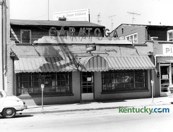 The Saratoga restaurant photographed April 10, 1978 at 856 East High Street was a Chevy Chase landmark and best known for its characters: bookies, college professors, socialites and city hall types. Totsie Rose opened it in 1953 and named it after the famous Saratoga Race Track in New York. Ted Mims owned it from 1977 to 1989. He bought it from Ed Whitlock, who had bought it from Rose. Rob Ramsey and Joe Reilly, co-owners of Ramsey's Diner, owned it for a short time. A Toga menu, served from 10 p.m. to 1 a.m. Monday through Saturday, featured Mrs. McKinney's snappy beer cheese ($2.95), fried bologna ($2.50), cold meatloaf on white ($4.95) and fried egg sandwich ($2.50). The hot plate special for a Derby weekend was chicken and dumplings for $6.95. Photo by John C. Wyatt | staff