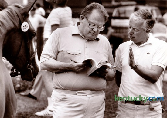Nelson Bunker Hunt, left, and Bloodstock agent Eugenio Colombo at the Fasig-Tipton Summer Yearling Sales in1985. Hunt, the former Texas billionaire, owned horses and farmland in seven Kentucky counties including the 257-acre Bluegrass Farm at Versailles Road and Man o' War Boulevard. Hunt, 88,  died in Dallas Tuesday October 21. Photo by Ron Garrison | Staff