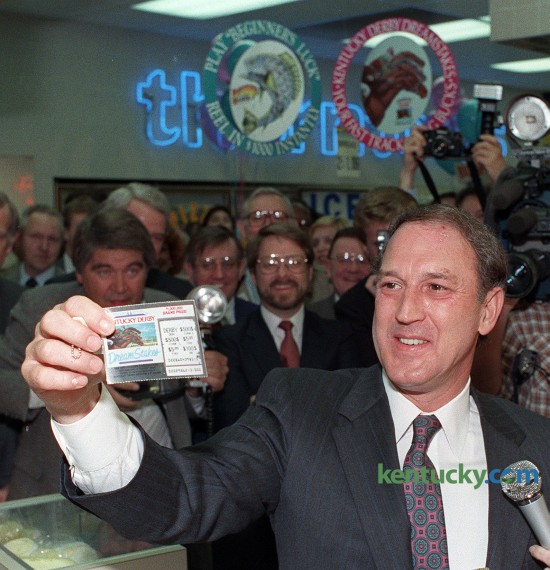 """Kentucky Gov. Wallace Wilkinson bought the first offical lottery ticket at a Thorntons gas station and food mart in Louisville April 4, 1989. Wilkinson, who made the creation of a lottery the cornerstone of his 1987 gubernatorial race, bought $3 worth of tickets and came up empty. Wilkinson turned and jokingly told lottery President Frank Keener that he """"could have organized this a little better."""" The governor later bought $100 worth of tickets -- 50 """"Beginner's Luck"""" and 25 """"DreamStakes"""" -- for his wife, Martha. Kentucky voters overwhelmingly supported the lottery in last fall's general election. The Kentucky Lottery Corporation says it has earned nearly $4 billion for Kentucky's state treasury since 1989. Photo by Frank Anderson 