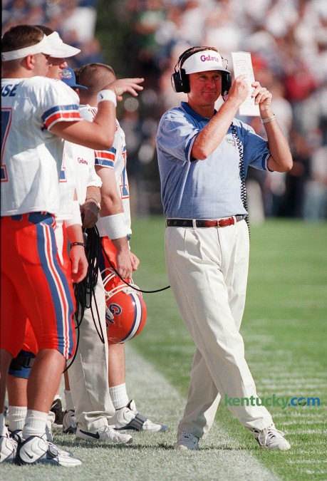 Florida coach Steve Spurrier tries to block the late afternoon sun during his Gators' 55-28 win over Kentucky Sept. 27, 1997 in Lexington. Spurrier was 12-0 against the Wildacts while at Florida. At South Carolina, Spurrier is 8-1 with the lone loss coming in 2010. Photo by Janet Worne | staff